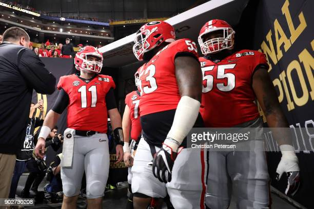 Jake Fromm Lamont Gaillard and Dyshon Sims walk out of the tunnel during warm ups prior to the game against the Alabama Crimson Tide in the CFP...