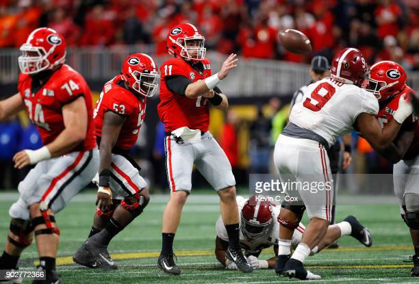 Jake Fromm of the Georgia Bulldogs attempts a pass resulting in an interception during the third quarter against the Alabama Crimson Tide in the CFP...