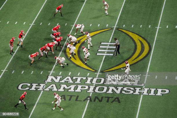 Jake Fromm of the Georgia Bulldogs awaits the snap against the Alabama Crimson Tide during the College Football Playoff National Championship held at...