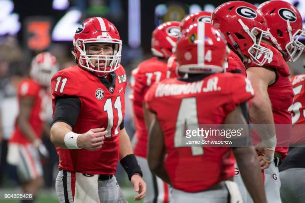 Jake Fromm of the Georgia Bulldogs calls a play against the Alabama Crimson Tide during the College Football Playoff National Championship held at...