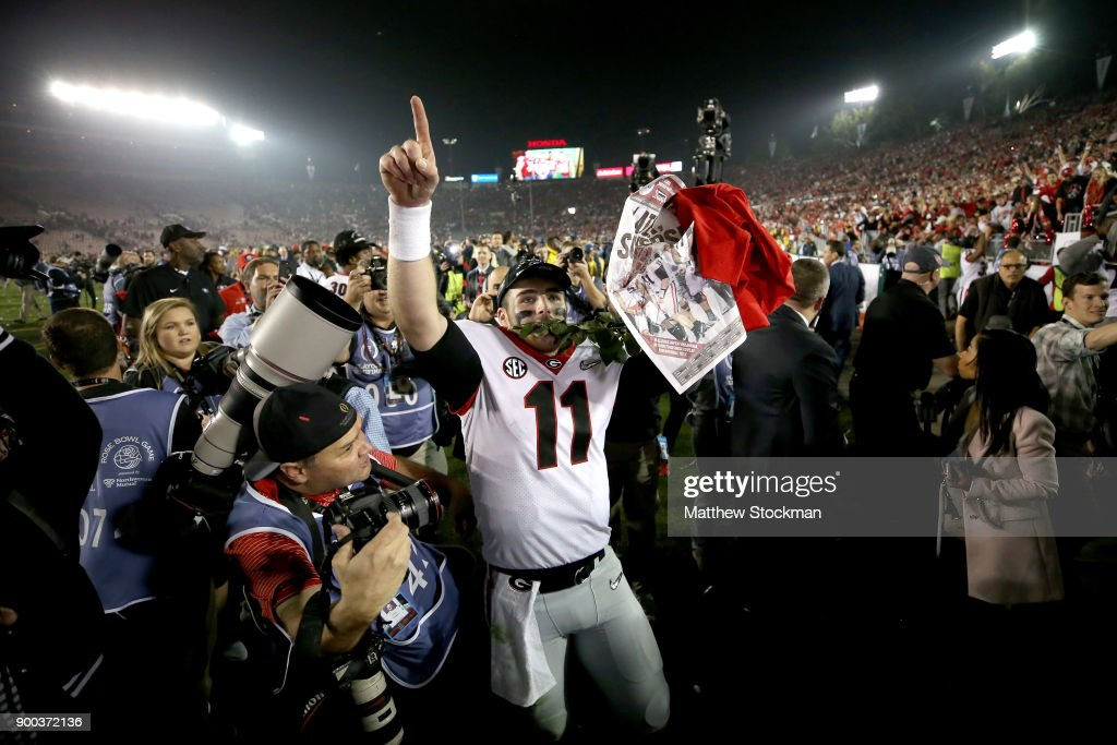 Jake Fromm #11 of the Georgia Bulldogs celebrates after the Bulldogs beat the Oklahoma Sooners in the 2018 College Football Playoff Semifinal Game at the Rose Bowl Game presented by Northwestern Mutual at the Rose Bowl on January 1, 2018 in Pasadena, California.