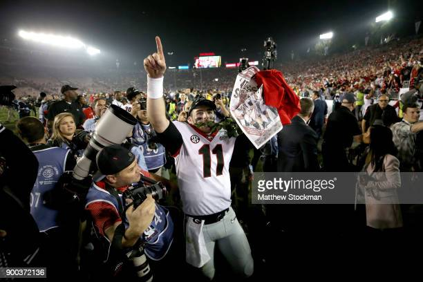 Jake Fromm of the Georgia Bulldogs celebrates after the Bulldogs beat the Oklahoma Sooners in the 2018 College Football Playoff Semifinal Game at the...