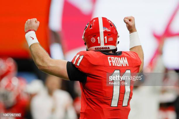 Jake Fromm of the Georgia Bulldogs celebrates in the first half against the Alabama Crimson Tide during the 2018 SEC Championship Game at...