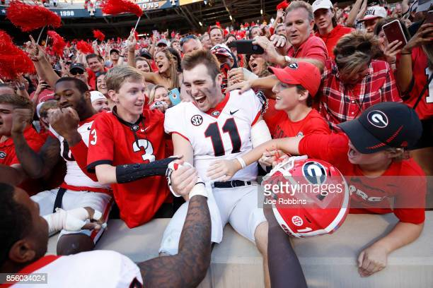 Jake Fromm of the Georgia Bulldogs celebrates with fans after a game against the Tennessee Volunteers at Neyland Stadium on September 30 2017 in...