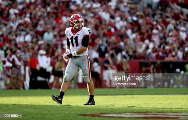 Jake Fromm of the Georgia Bulldogs checks the sidelines against the South Carolina Gamecocks during their game at WilliamsBrice Stadium on September...