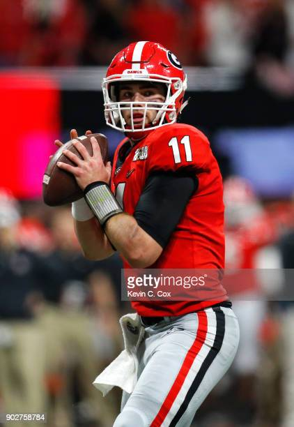 Jake Fromm of the Georgia Bulldogs drops back to pass during the second quarter against the Alabama Crimson Tide in the CFP National Championship...