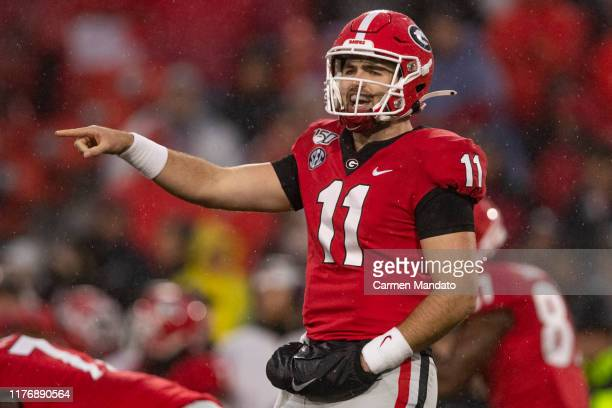 Jake Fromm of the Georgia Bulldogs gestures during the first half of a game against the Kentucky Wildcats at Sanford Stadium on October 19 2019 in...