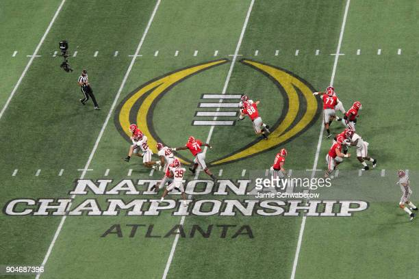 Jake Fromm of the Georgia Bulldogs is sacked by Anthony Averett of the Alabama Crimson Tide during the College Football Playoff National Championship...