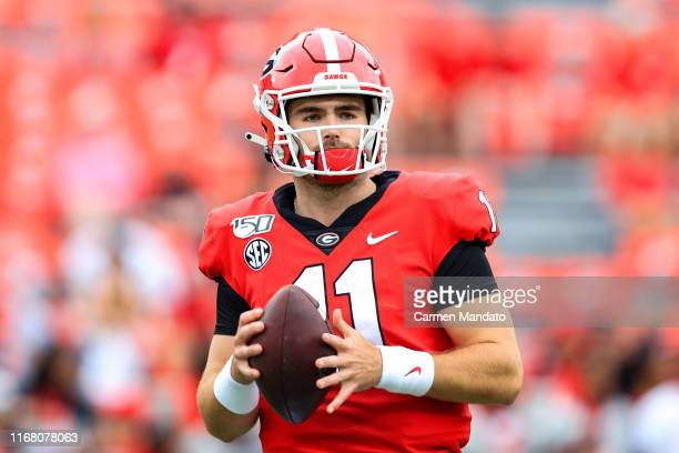 Jake Fromm of the Georgia Bulldogs looks on prior to the start of the game against the Arkansas State Red Wolves at Sanford Stadium on September 14...