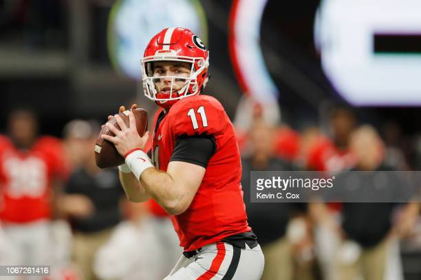 Jake Fromm of the Georgia Bulldogs looks to pass in the first half against the Alabama Crimson Tide during the 2018 SEC Championship Game at...