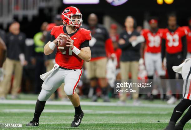 Jake Fromm of the Georgia Bulldogs looks to pass the ball in the first half against the Alabama Crimson Tide during the 2018 SEC Championship Game at...