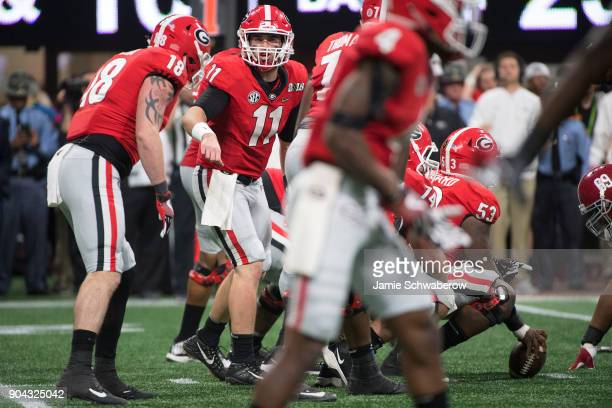 Jake Fromm of the Georgia Bulldogs makes a call at the line against the Alabama Crimson Tide during the College Football Playoff National...
