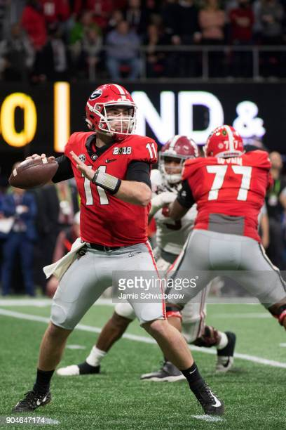 Jake Fromm of the Georgia Bulldogs passes against the Alabama Crimson Tide during the College Football Playoff National Championship held at...