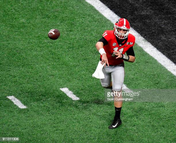 Jake Fromm of the Georgia Bulldogs passes against the Alabama Crimson Tide in the CFP National Championship presented by ATT at MercedesBenz Stadium...