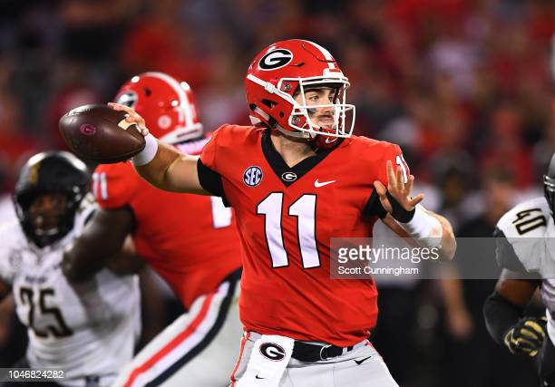 Jake Fromm of the Georgia Bulldogs passes against the Vanderbilt Commodores on October 6 2018 at Sanford Stadium in Athens Georgia