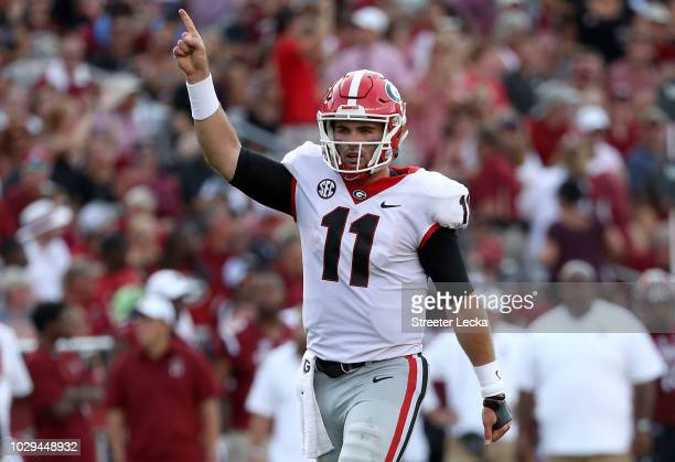 Jake Fromm of the Georgia Bulldogs reacts after a touchdown against the South Carolina Gamecocks during their game at WilliamsBrice Stadium on...