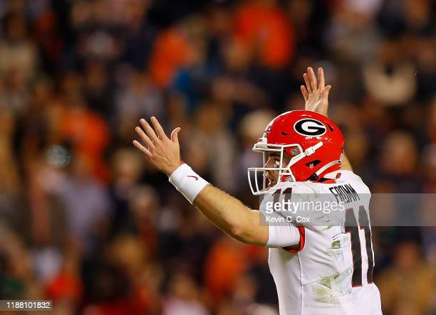 Jake Fromm of the Georgia Bulldogs reacts after passing for a touchdown to Eli Wolf in the second half against the Auburn Tigers at Jordan-Hare...