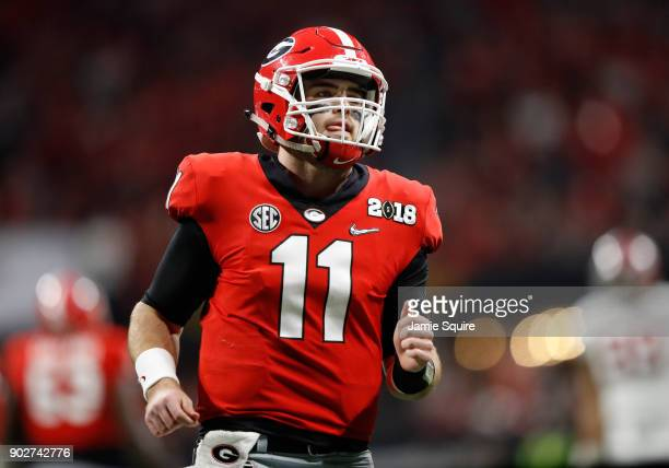 Jake Fromm of the Georgia Bulldogs reacts to a play during the first quarter against the Alabama Crimson Tide in the CFP National Championship...