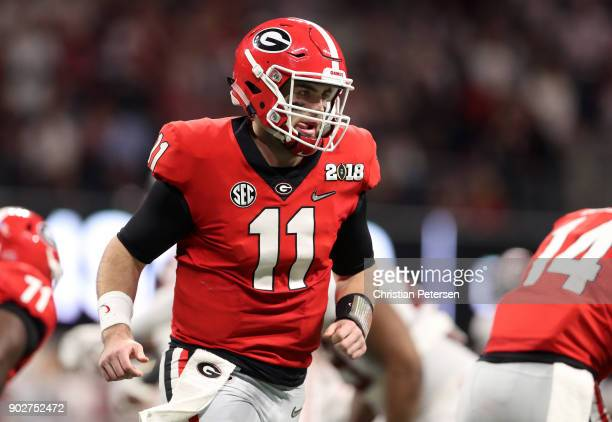 Jake Fromm of the Georgia Bulldogs reacts to a play during the second quarter against the Alabama Crimson Tide in the CFP National Championship...