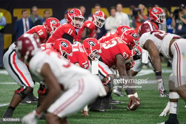 Jake Fromm of the Georgia Bulldogs receives the snap against the Alabama Crimson Tide during the College Football Playoff National Championship held...