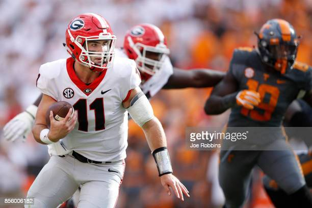 Jake Fromm of the Georgia Bulldogs runs for a nineyard touchdown in the second quarter of a game against the Tennessee Volunteers at Neyland Stadium...