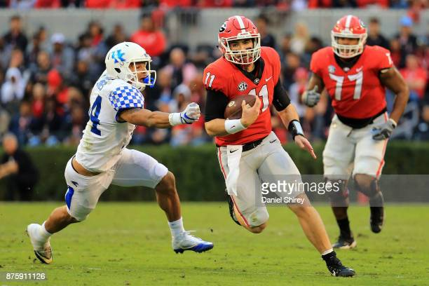 Jake Fromm of the Georgia Bulldogs runs the ball during the first half against the Kentucky Wildcats at Sanford Stadium on November 18 2017 in Athens...