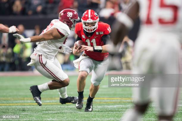 Jake Fromm of the Georgia Bulldogs rushes against the Alabama Crimson Tide during the College Football Playoff National Championship held at...