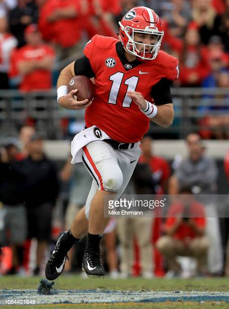 Jake Fromm of the Georgia Bulldogs rushes during a game against the Florida Gators at TIAA Bank Field on October 27 2018 in Jacksonville Florida