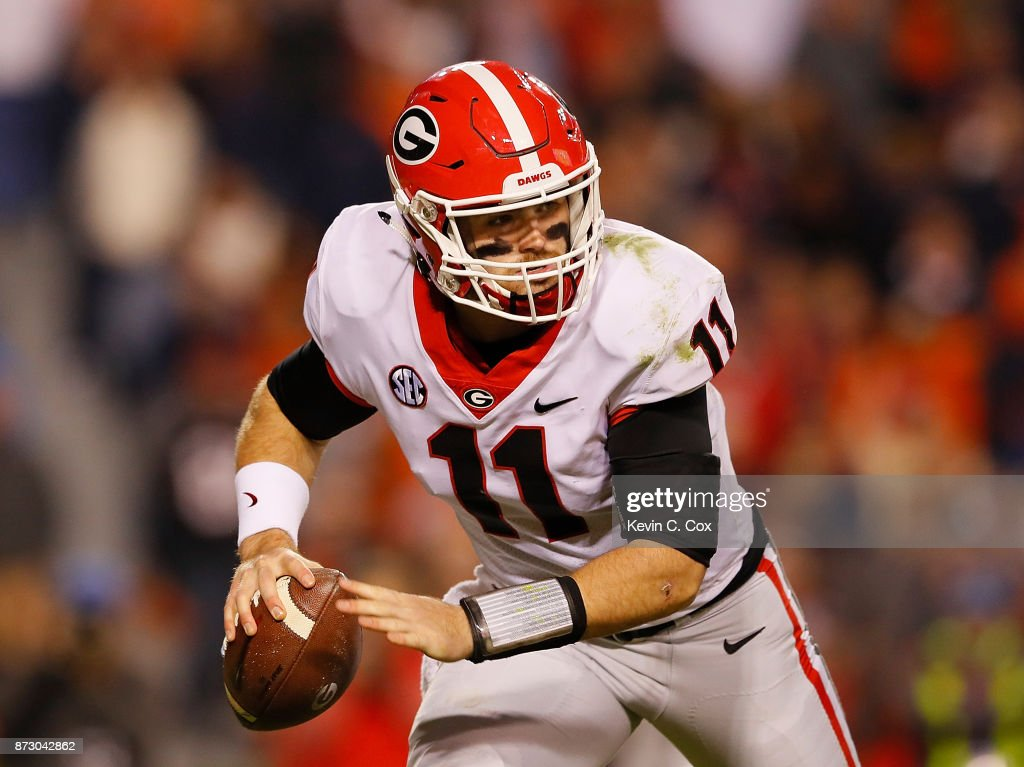 Jake Fromm #11 of the Georgia Bulldogs rushes out of the pocket against the Auburn Tigers at Jordan Hare Stadium on November 11, 2017 in Auburn, Alabama.