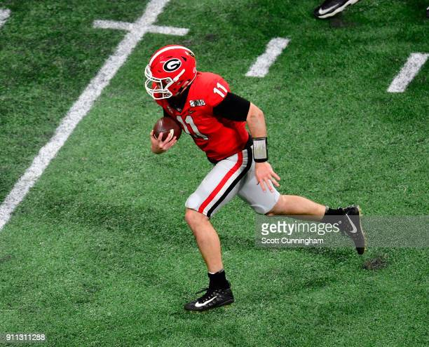 Jake Fromm of the Georgia Bulldogs scrambles against the Alabama Crimson Tide in the CFP National Championship presented by ATT at MercedesBenz...