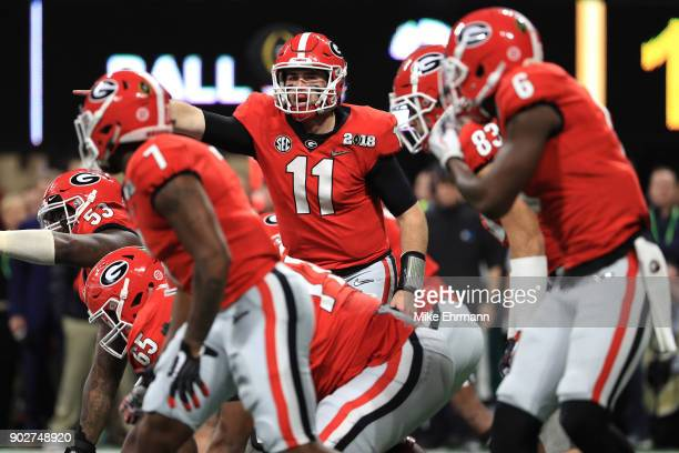 Jake Fromm of the Georgia Bulldogs signals to his team during the second quarter against the Alabama Crimson Tide in the CFP National Championship...
