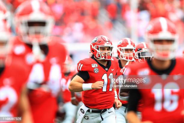 Jake Fromm of the Georgia Bulldogs takes the field during the first half of a game against the Arkansas State Red Wolves at Sanford Stadium on...