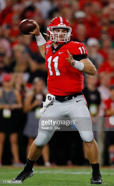 Jake Fromm of the Georgia Bulldogs throws a first half pass while playing the Notre Dame Fighting Irish at Sanford Stadium on September 21, 2019 in...