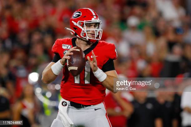 Jake Fromm of the Georgia Bulldogs throws a first half pass while playing the Notre Dame Fighting Irish at Sanford Stadium on September 21 2019 in...