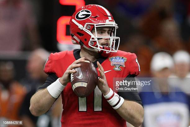 Jake Fromm of the Georgia Bulldogs throws a pass against the Texas Longhorns during the Allstate Sugar Bowl at MercedesBenz Superdome on January 01...