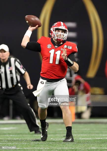 Jake Fromm of the Georgia Bulldogs throws a pass during the first quarter against the Alabama Crimson Tide in the CFP National Championship presented...