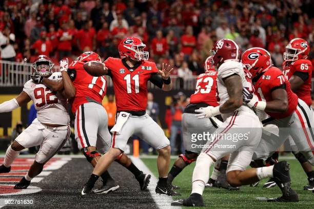 Jake Fromm of the Georgia Bulldogs throws a pass during the second quarter against the Alabama Crimson Tide in the CFP National Championship...
