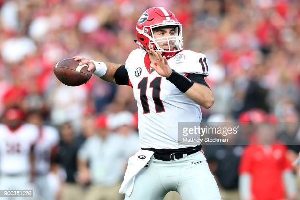 Jake Fromm of the Georgia Bulldogs throws a pass in the 2018 College Football Playoff Semifinal at the Rose Bowl Game presented by Northwestern...