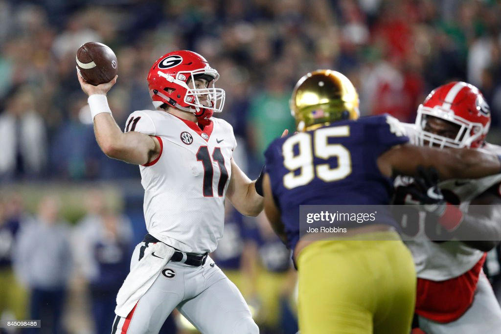 Jake Fromm #11 of the Georgia Bulldogs throws a pass in the fourth quarter of a game against the Notre Dame Fighting Irish at Notre Dame Stadium on September 9, 2017 in South Bend, Indiana. Georgia won 20-19.