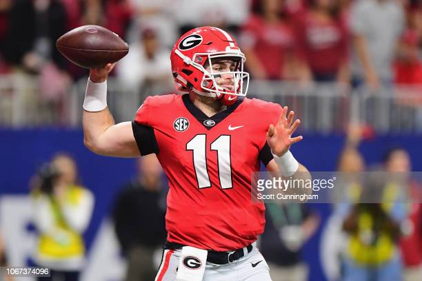 Jake Fromm of the Georgia Bulldogs throws a pass in the second half against the Alabama Crimson Tide during the 2018 SEC Championship Game at...