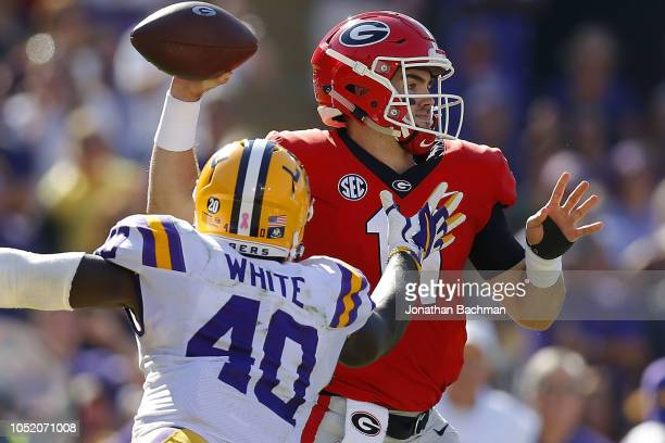 Jake Fromm of the Georgia Bulldogs throws the ball as Devin White of the LSU Tigers defends during the first half at Tiger Stadium on October 13 2018...