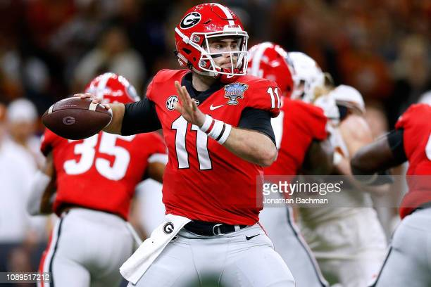 Jake Fromm of the Georgia Bulldogs throws the ball during the first half of the Allstate Sugar Bowl against the Texas Longhorns at the MercedesBenz...