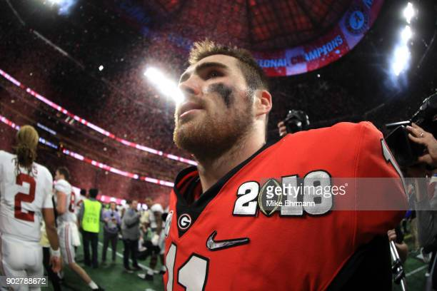 Jake Fromm of the Georgia Bulldogs walks off the field after being defeated by the Alabama Crimson Tide in the CFP National Championship presented by...