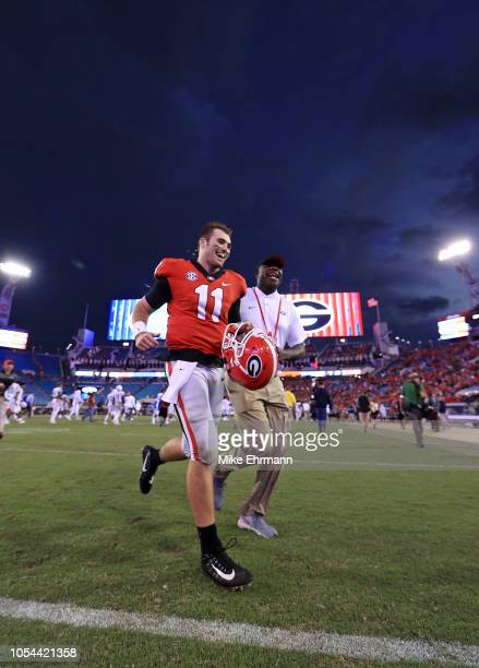 Jake Fromm of the Georgia Bulldogs walks off the field following a game against the Florida Gators at TIAA Bank Field on October 27 2018 in...