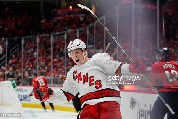 Jake Gardiner of the Carolina Hurricanes celebrates after scoring the game winning goal in overtime against the Washington Capitals at Capital One...