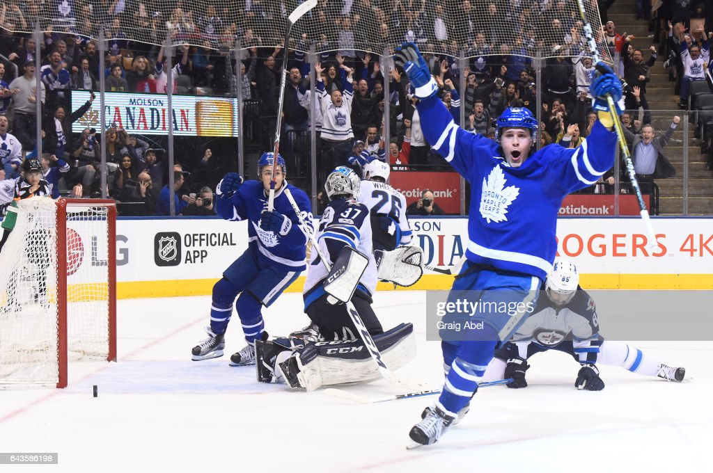 Jake Gardiner #51 of the Toronto Maple Leafs celebrates his game winning overtime goal on Connor Hellebuyck #37 of the Winnipeg Jets at the Air Canada Centre on February 21, 2017 in Toronto, Ontario, Canada.