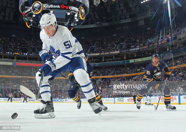 Jake Gardiner of the Toronto Maple Leafs controls the puck against Justin Bailey of the Buffalo Sabres during an NHL game on March 15 2018 at KeyBank...