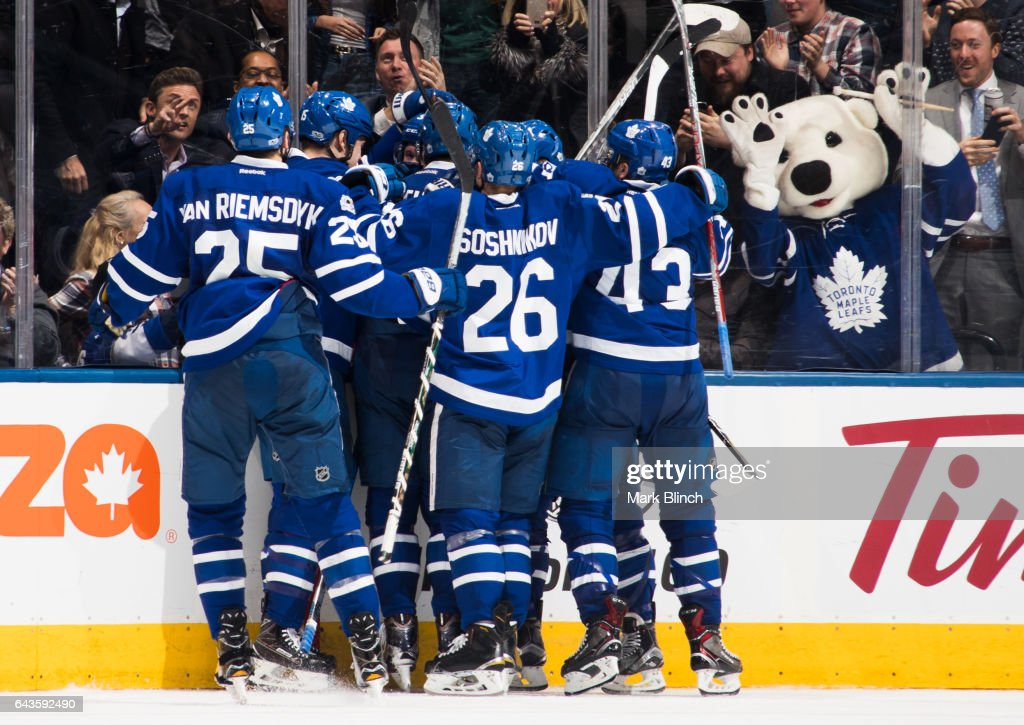 Jake Gardiner #51 of the Toronto Maple Leafs is mobbed by teammates after scoring the game winning overtime goal against the Winnipeg Jets at the Air Canada Centre on February 21, 2017 in Toronto, Ontario, Canada.