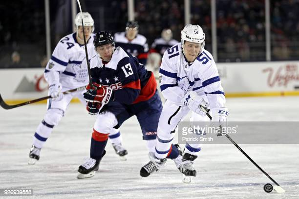 Jake Gardiner of the Toronto Maple Leafs skates past Jakub Vrana of the Washington Capitals during the second period in the Coors Light NHL Stadium...