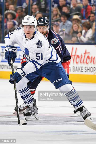 Jake Gardiner of the Toronto Maple Leafs skates with the puck against the Columbus Blue Jackets on October 31 2014 at Nationwide Arena in Columbus...